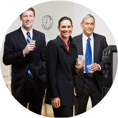 Business people drinking from bottleless cooler